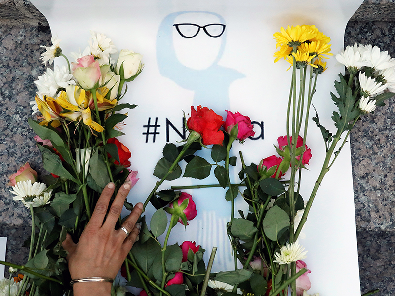An attendee leaves flowers during a vigil for Nabra Hassanen in New York City on June 20, 2017. Photo courtesy of Reuters/Brendan McDermid