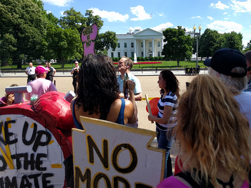 People protest against President Trump pulling out of the Paris climate agreement on June 1, 2017, at the White House in Washington, D.C. RNS photo by Jerome Socolovsky