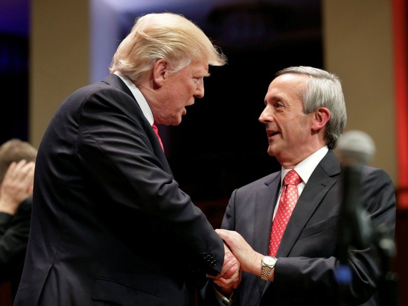 President Donald Trump, left, is greeted by Pastor Robert Jeffress of Dallas at the Celebrate Freedom Rally on July 1, 2017, in Washington, D.C. Photo by Yuri Gripas/Reuters