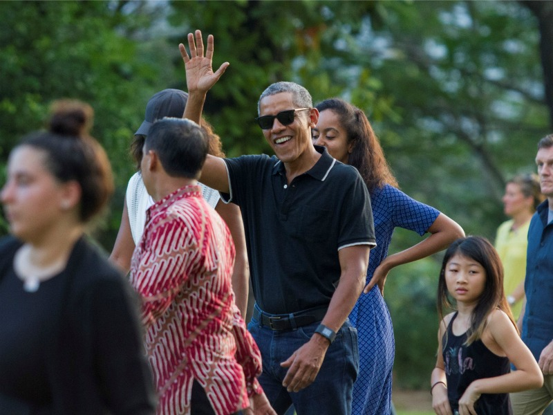 Former President Obama, center, waves while walking with his daughter Malia during a visit June 28, 2017, to the ninth-century Borobudur Temple in Magelang, Central Java, Indonesia. Photo by Pius Erlangga/Reuters