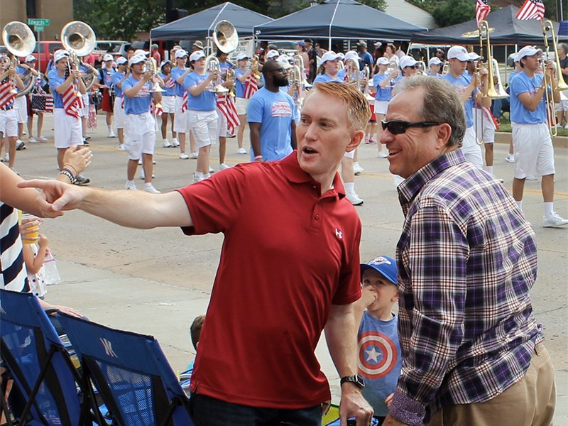 U.S. Sen. James Lankford, R-Okla., visits with constituents during the LibertyFest parade on the Fourth of July in Edmond, Okla., north of Oklahoma City. RNS photo by Bobby Ross Jr.