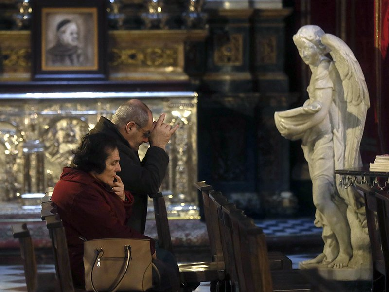 Faithful pray in St. John Cathedral in downtown Valletta, Malta, on Feb. 2, 2017. The predominantly Roman Catholic island nation of Malta is set to legalize gay marriage, joining much of Western Europe. Photo by Gregorio Borgia/AP