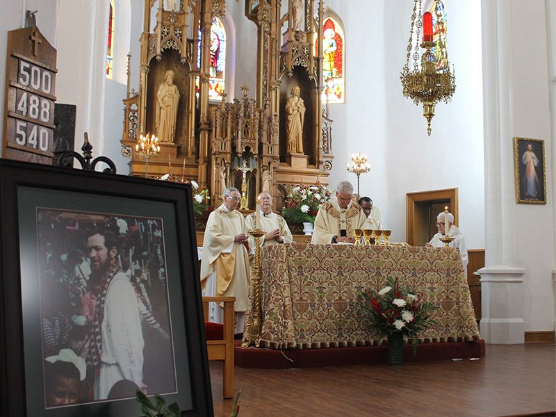 A portrait of the Rev. Stanley Francis Rother sits at the front of Holy Trinity Catholic Church in Okarche, Okla., on July 29, 2017, as Oklahoma City Archbishop Paul S. Coakley celebrates a 36th anniversary memorial Mass for the slain priest. The missionary priest was shot dead on July 28, 1981, during Guatemala's bloody civil war and will be beatifiedSept. 23in Oklahoma City. RNS photo by Keaton Ross