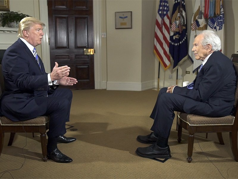 """President Trump talks with the Rev. Pat Robertson during an interview for """"The 700 Club"""" on the Christian Broadcasting Network. Photo courtesy of CBN"""