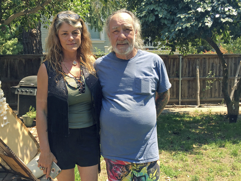 Heidi and Charles Lepp, who run the Sugarleaf Rastafarian Church, stand in the backyard of their Sacramento, Calif., home on Aug. 2, 2017. The Lepps use cannabis as a sacrament in their religion. The shooting of two California deputies responding to a disturbance at the Rastafarian marijuana farm has drawn attention to religious use of the drug, sparking debate over whether churches should be protected from drug prosecutions. (AP Photo/Kathleen Ronayne)
