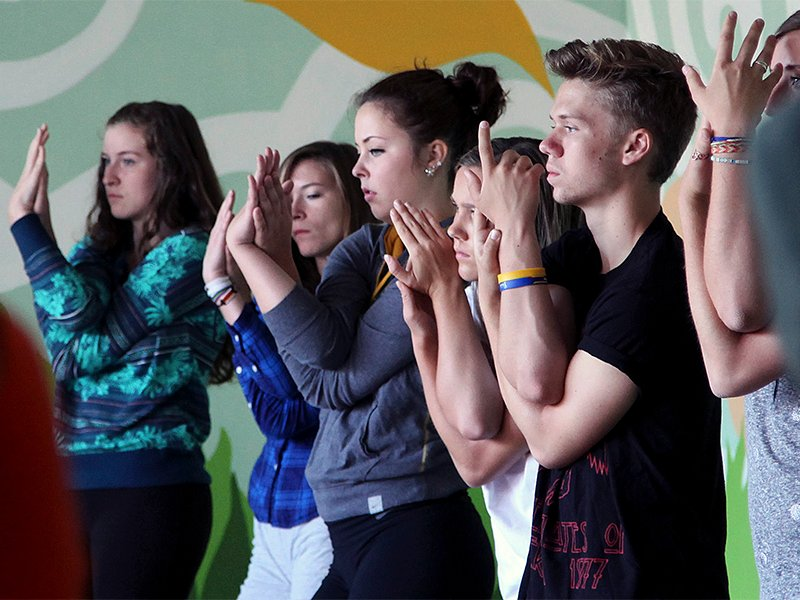 """Students work on yoga postures during """"mindful studies"""" class at Wilson High School in Portland, Oregon, on Oct. 1, 2014.(AP Photo/Gosia Wozniacka)"""