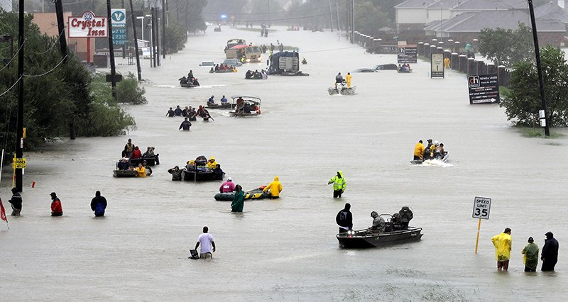 Rescue boats fill a flooded street as flood victims are evacuated as floodwaters from Tropical Storm Harvey rise on Aug. 28, 2017, in Houston. (AP Photo/David J. Phillip)
