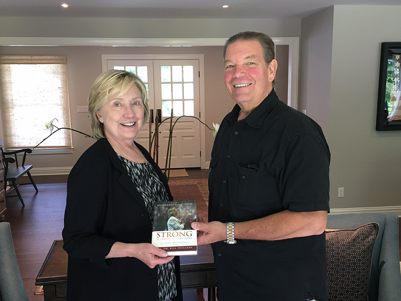 """Hillary Clinton and the Rev. Bill Shillady with the book """"Strong for a Moment Like This."""" Photo courtesy of the Rev. Bill Shillady"""