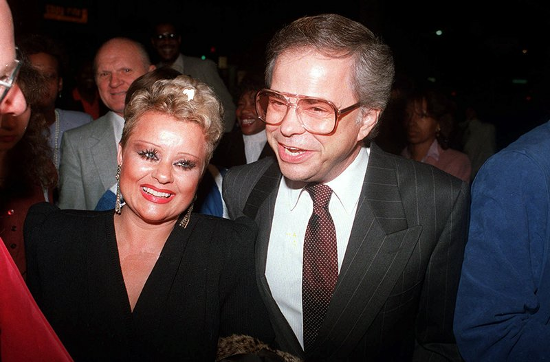 """Jim and Tammy Faye Bakker enjoy a night on the town on Oct. 24, 1987 as they arrive at the Beverly Theatre to see the show """"The Gospel Truth."""" (AP Photo/Douglas C. Pizac)"""