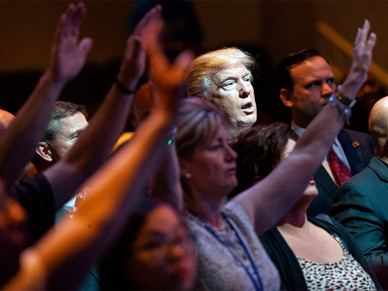 Republican presidential candidate Donald Trump stands during a service at the International Church of Las Vegas on Oct. 30, 2016. (AP Photo/Evan Vucci, File)