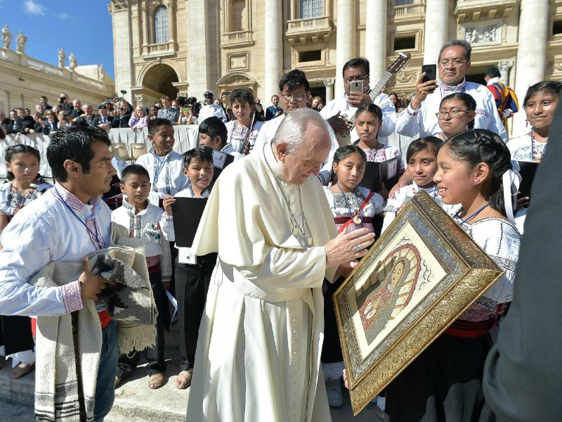 Pope Francis meets members of a children's choir from Mexico during his weekly general audience in St. Peter's Square at the Vatican on Sept. 20, 2017. The pontiff prayed for the victims of the 7.1-magnitude quake that hit Mexico on Tuesday, leaving several hundred dead, including children trapped under a collapsed school in Mexico City. (L'osservatore Romano/Pool Photo via AP)