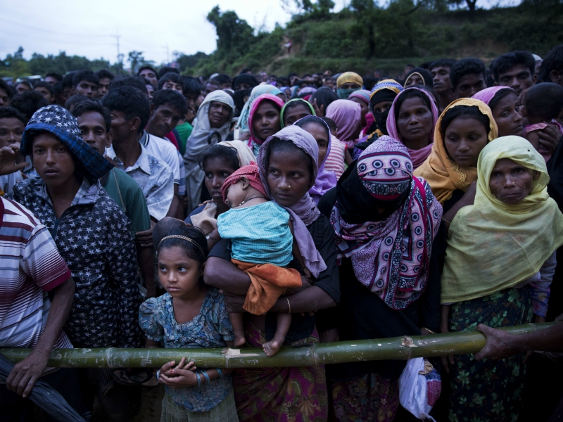 Rohingya Muslims, who crossed over recently from Myanmar into Bangladesh, stand in queues to receive food being distributed near Balukhali refugee camp in Cox's Bazar, Bangladesh, on Sept. 19, 2017. More than 500,000 Rohingya Muslims have fled to neighboring Bangladesh in the past year, most of them in the last three weeks, after security forces and allied mobs retaliated for a series of attacks by Muslim militants last month by burning down thousands of Rohingya homes in the predominantly Buddhist nation. (AP Photo/Bernat Armangue)