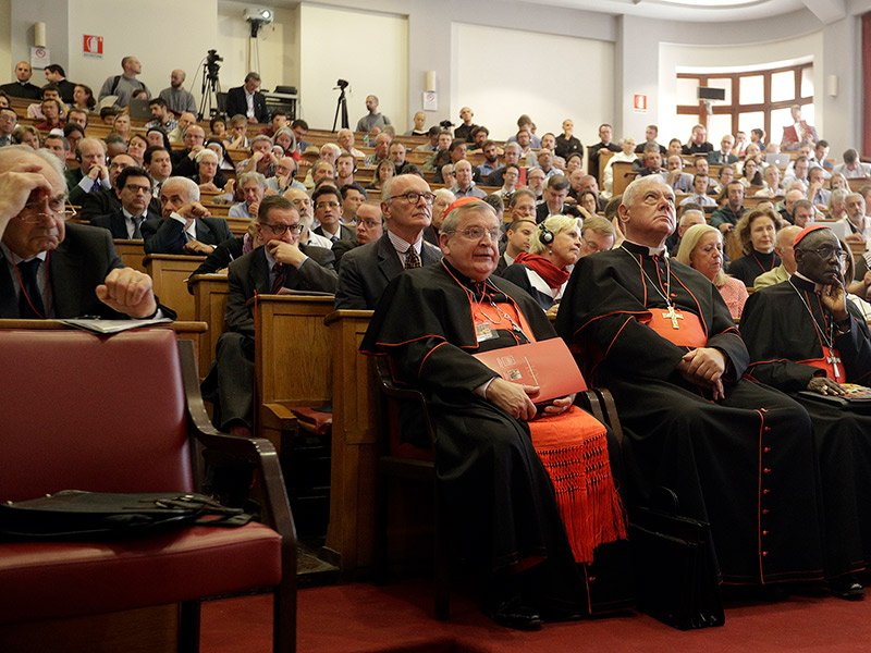 From left, former Chairman of the Vatican Bank Ettore Gotti Tedeschi and Cardinals Raymond Leo Burke, Gerhard Ludwig Mueller and Robert Sarah attend a conference on the Latin Mass at the Pontifical University of St. Thomas Aquinas in Rome on Thursday, Sept. 14, 2017. (AP Photo/Gregorio Borgia)