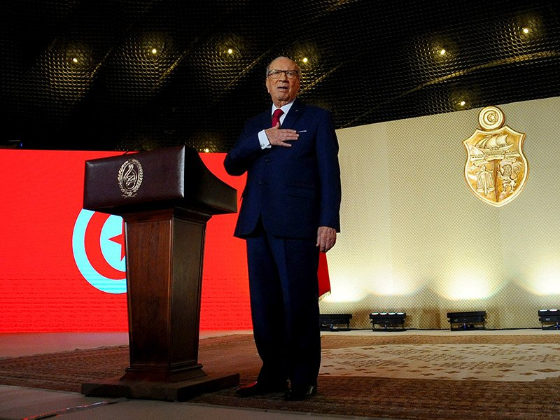 Tunisian President Beji Caid Essebsi sings the national anthem after making a speech in Tunis on May 10, 2017. AP Photo/Hassene Dridi