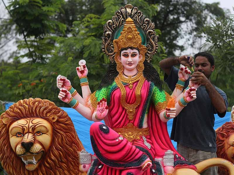 An Indian artisan gives finishing touches to an idol of Hindu goddess Durga, sculpted for Navaratri, or the festival of nine nights, in Hyderabad, India, on Sept. 30, 2016. AP Photo/Mahesh Kumar A.