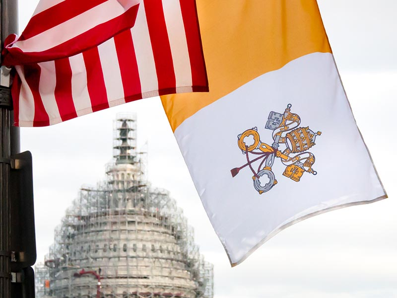 Vatican flags along Pennsylvania Avenue for Pope Francis' visit in 2015. Photo courtesy of Victoria Pickering/Flickr Creative Commons