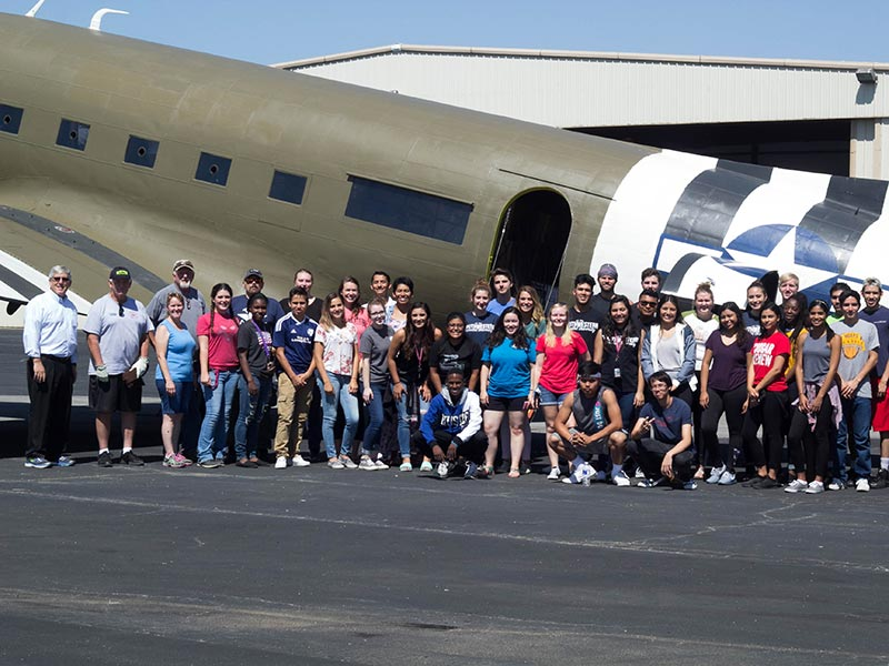 The Christian Ethics and Christian Beliefs classes, under the guidance of Dr. Bill Kilgore and Pastor Russ Laughlin, VP for Spiritual Development at Southwestern Adventist University, load a plane with supplies headed to aid Hurricane Harvey victims. Photo courtesy of Southwestern Adventist University