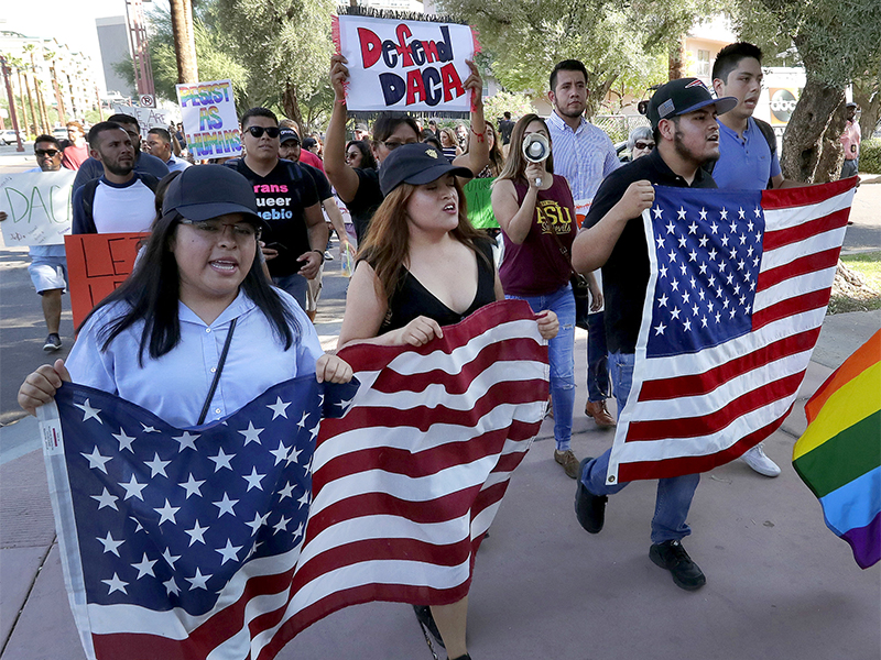 Deferred Action for Childhood Arrivals (DACA) supporters march to the Immigration and Customs Enforcement office to protest shortly after U.S. Attorney General Jeff Sessions' announcement that DACA will be suspended with a six-month delay on Sept. 5, 2017, in Phoenix, Ariz. (AP Photo/Matt York)