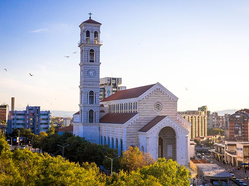View of the Mother Teresa Cathedral in downtown Pristina, the tallest building in Kosovo, also known as the Sanctuary of Mother Teresa. Photo by Valerie Plesch