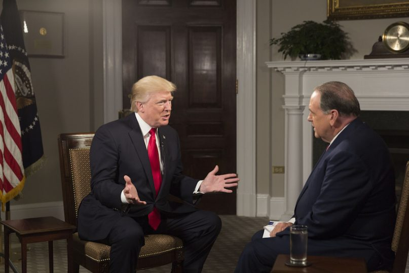 President Donald J. Trump participates in an interview with Former Arkansas Governor Mike Huckabee of the Trinity Broadcast Network in the Roosevelt Room at the White House, Thursday, October 5, 2017, in Washington, D.C. (Official White House Photo by Joyce N. Boghosian)