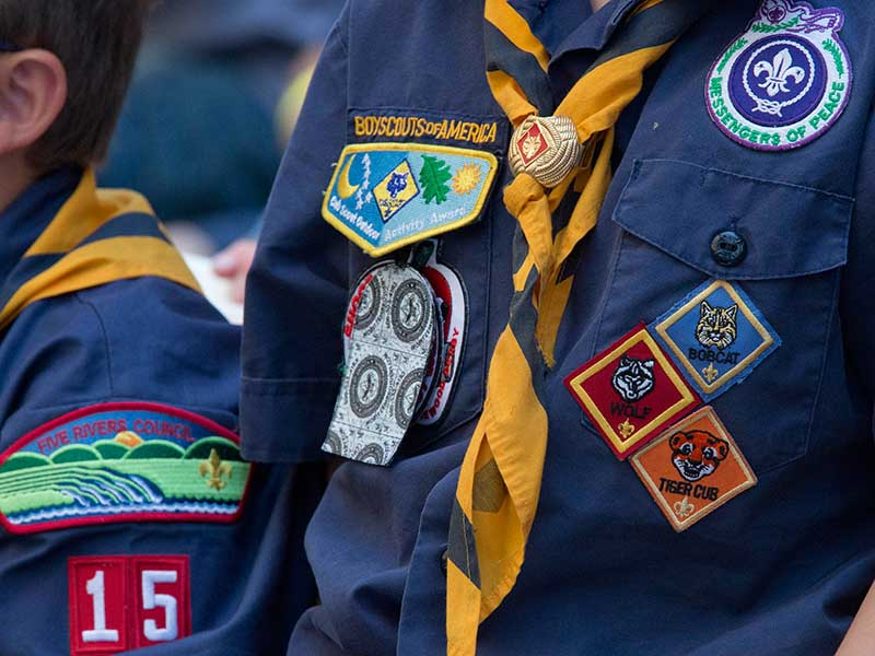 In this June 25, 2016, file photo, Cub Scouts watch a race during the second annual World Championship Pinewood Derby in New York's Times Square. AP Photo/Mary Altaffer