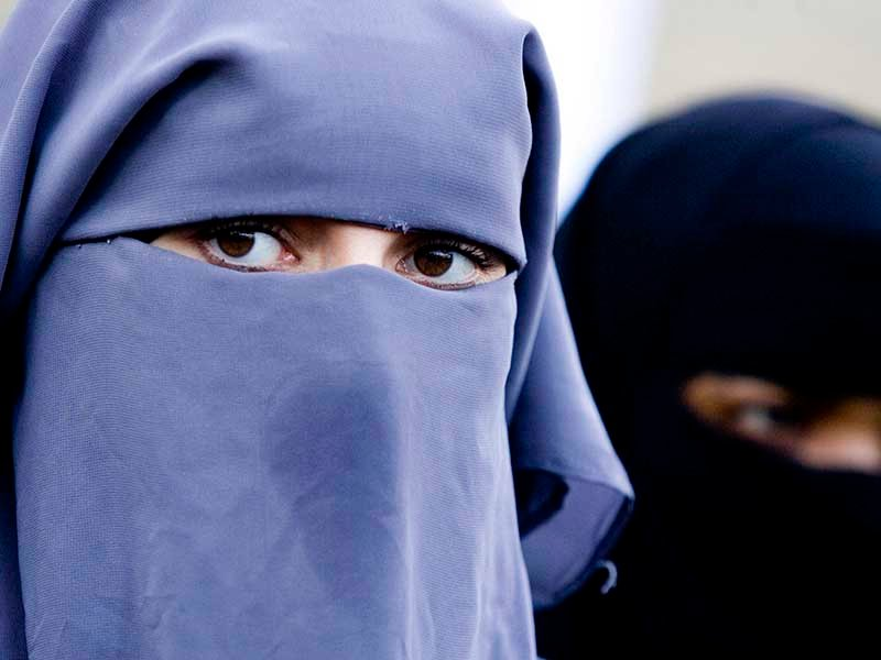 In this Nov. 30, 2006, file photo, unidentified women are seen wearing a niqab during a demonstration outside the Dutch Parliament in The Hague, Netherlands. AP photo/ Fred Ernst, File