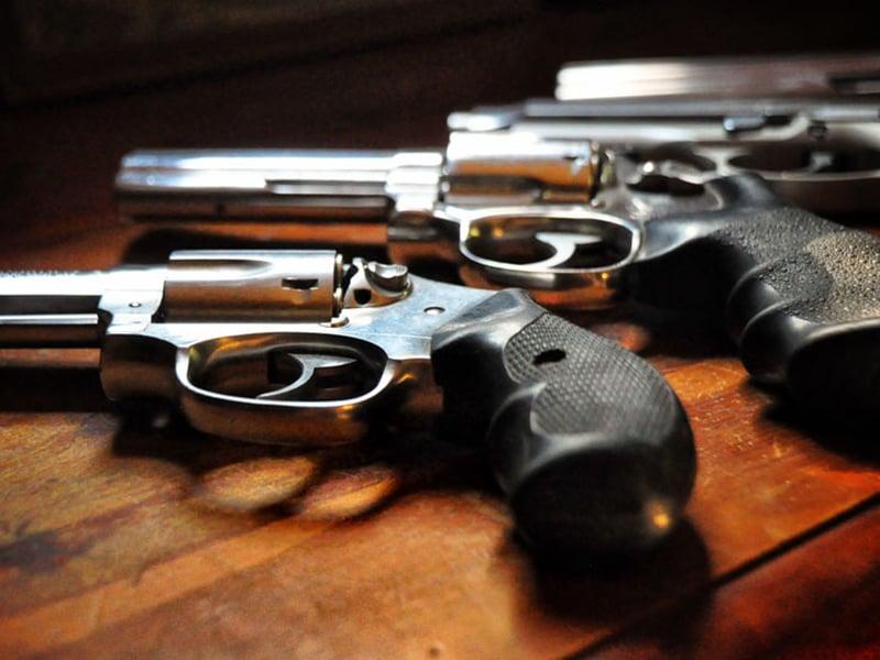 Guns on a table. Photo courtesy of Rod Waddington via Flickr.