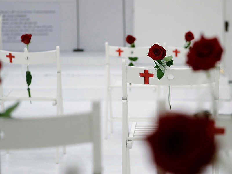A memorial for the victims of the shooting at Sutherland Springs First Baptist Church, including 26 white chairs each painted with a cross and adorned with a rose, is displayed in the church Nov. 12, 2017, in Sutherland Springs, Texas. A man opened fire inside the church in the small South Texas community last week, killing more than two dozen. (AP Photo/Eric Gay)