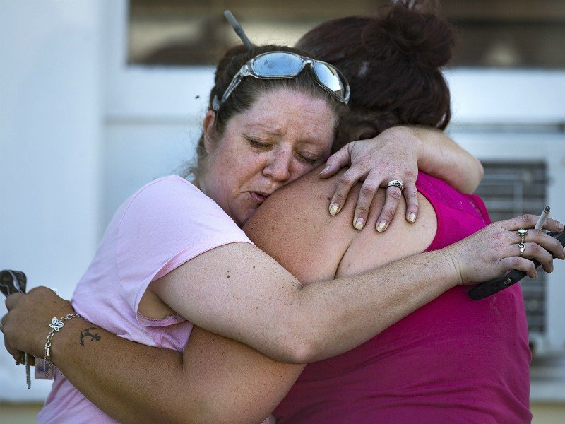 Carrie Matula hugs a woman who lost her father in a mass shooting at the First Baptist Church in Sutherland Springs, Texas, on Sunday, Nov. 5, 2017. Matula said she saw and heard everything as it happened from the gas station where she works just a block away. NICK WAGNER / AMERICAN-STATESMAN