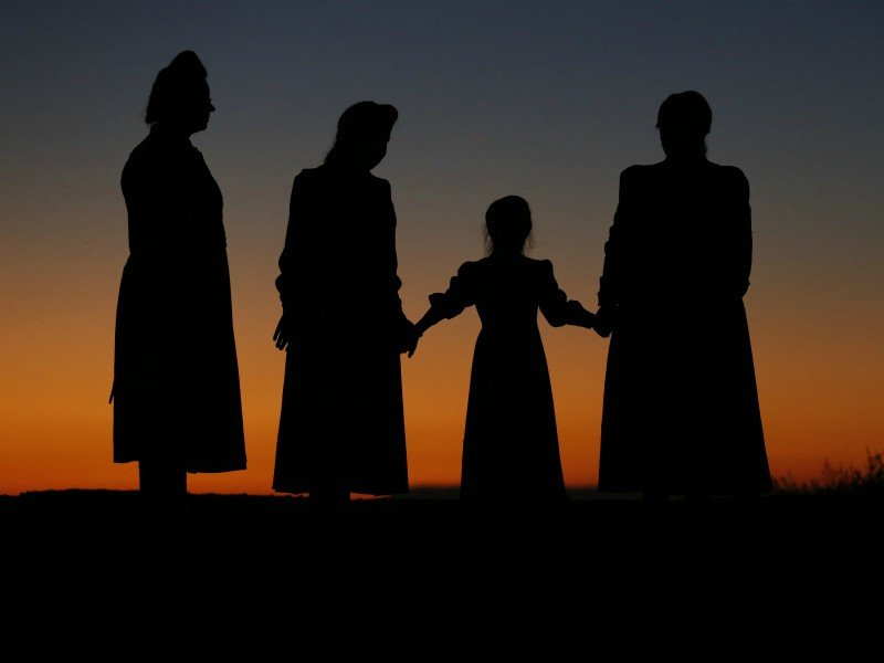In this Wednesday, Oct. 25, 2017 photo, from left, Esther Bistline, Angie Bistline, Lydia Ann Richter and Norma Richter gather to pose for photographs in Colorado City, Ariz. The community on the Utah-Arizona border has been home for more than a century to a polygamous sect that is an offshoot of mainstream Mormonism. (AP Photo/Rick Bowmer)