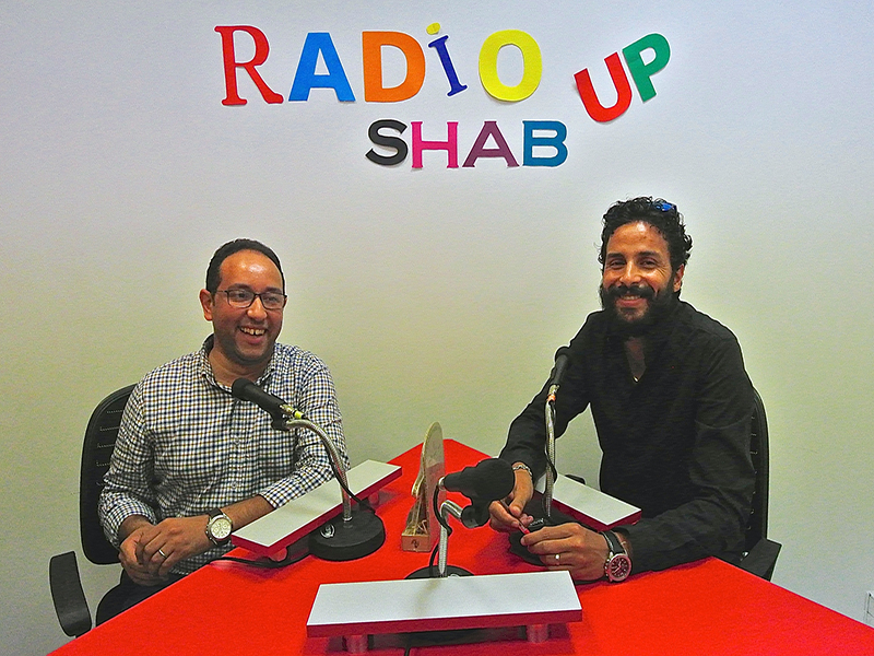 Chababe director Yassine Souidi, left, and colleague Driss Qarqouri sit in the Chababe studio in Rabat, Morocco, where they record interviews for audio and video clips. RNS photo by Tom Heneghan