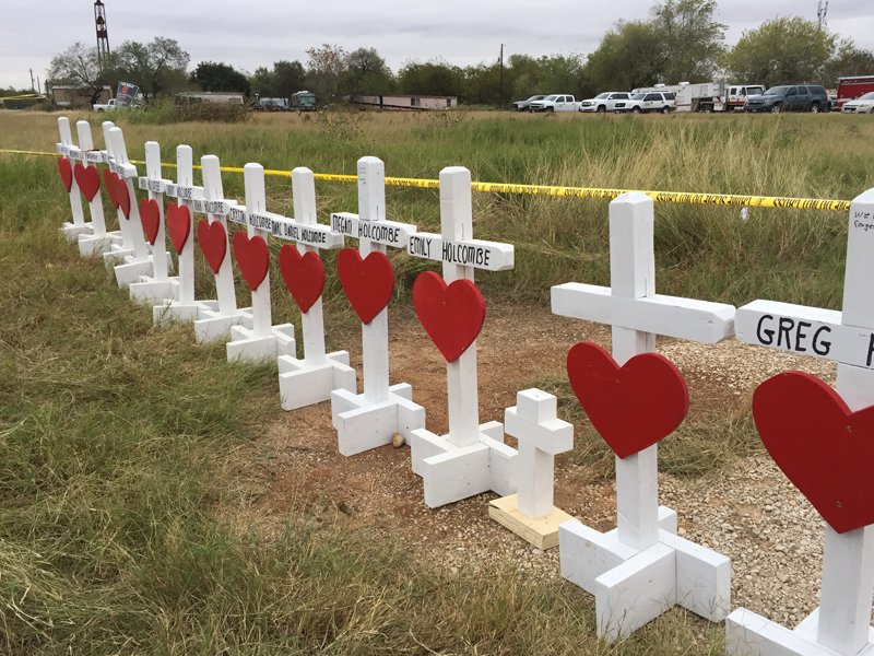 A row of crosses with the names of those killed on the corner of First Baptist Church beside U.S. Highway 87. RNS photo by Yonat Shimron