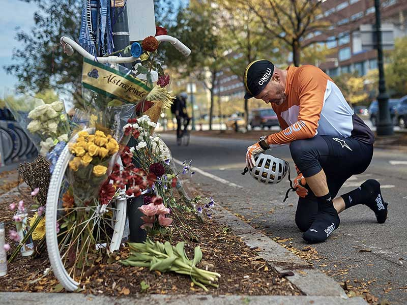 Eric Fleming, 41, stops by to express his condolences Nov. 2, 2017, in front of a bike memorial where people leave flowers to remember the victims of the attack in New York. A man in a rented truck mowed down pedestrians and cyclists along the busy bike path near the World Trade Center memorial on Oct. 31, killing eight and seriously injuring others in what the mayor called