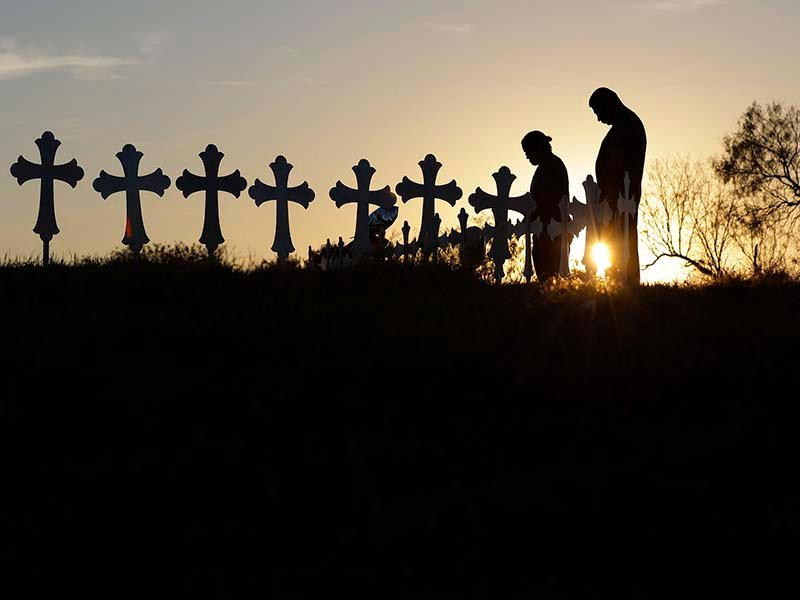 Kenneth and Irene Hernandez pay their respects as they visit a makeshift memorial with crosses placed near the scene of a shooting at the First Baptist Church of Sutherland Springs, on Nov. 6, 2017, in Sutherland Springs, Texas. A man opened fire inside the church in the small South Texas community on Sunday, killing and wounding many. (AP Photo/Eric Gay)