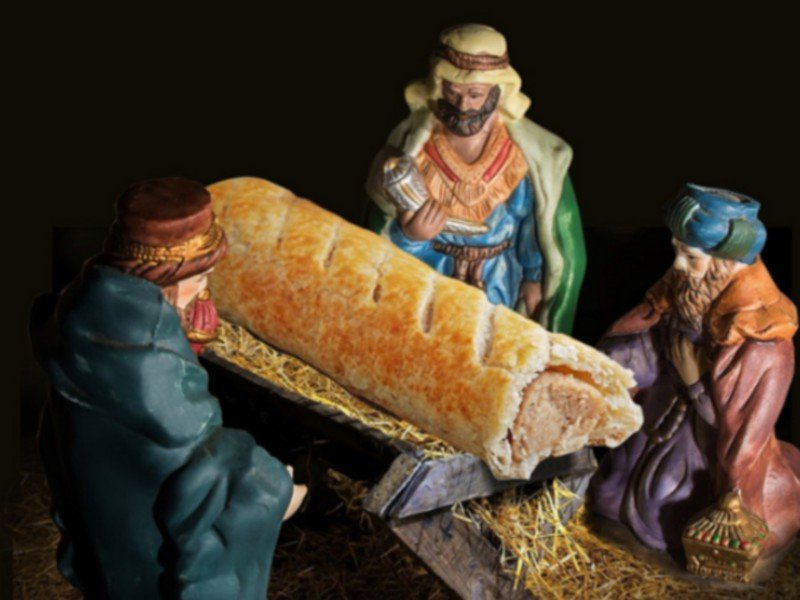 Britain's biggest bakery apologized after replacing the traditional baby Jesus in the manger with a sausage roll in a nativity scene. Photo via Greggs