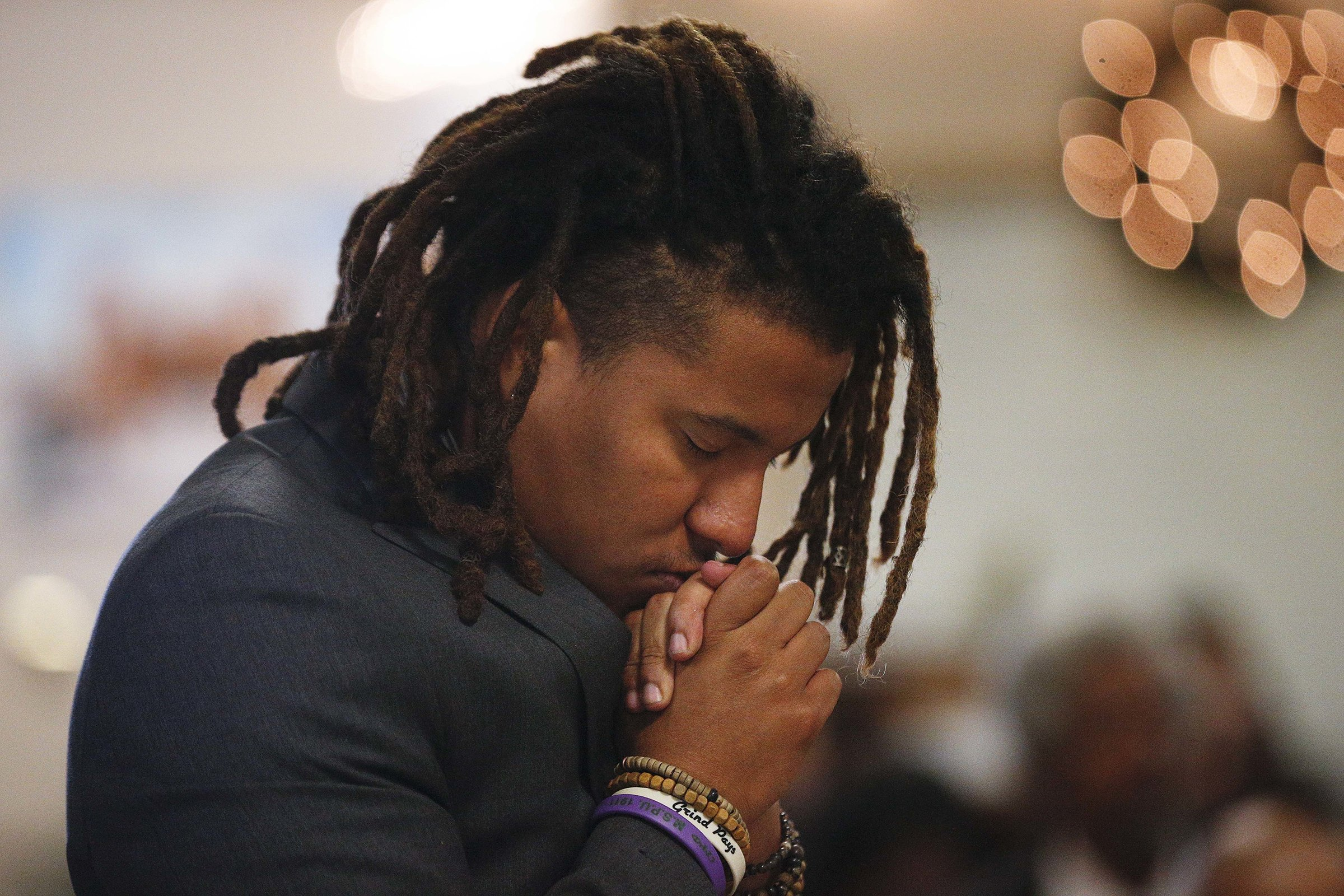 """Jeremiah Chapman, prays during a 16th Street Baptist church service, Sunday, Dec. 10, 2017, in Birmingham, Ala. At the church pastor Arthur Price told the mostly black congregation that Alabama's U.S. Senate election is too important to skip. """"There's too much at stake for us to stay home,"""" Price said of Tuesday's election. (AP Photo/Brynn Anderson)"""