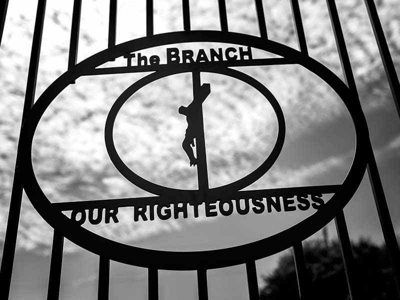 Detail from the entrance gate at the Mount Carmel Center (Branch Davidian compound), outside of Waco, Texas | Photo Credit: Lorie Shaull/Flickr (cc)