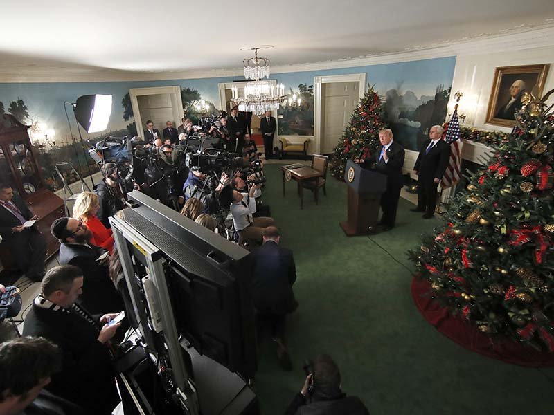 President Donald Trump, accompanied by Vice President Mike Pence, speaks in the Diplomatic Reception Room of the White House, Wednesday, Dec. 6, 2017, in Washington. Trump recognized Jerusalem as Israel's capital despite intense Arab, Muslim and European opposition to a move that would upend decades of U.S. policy and risk potentially violent protests. (AP Photo/Alex Brandon)