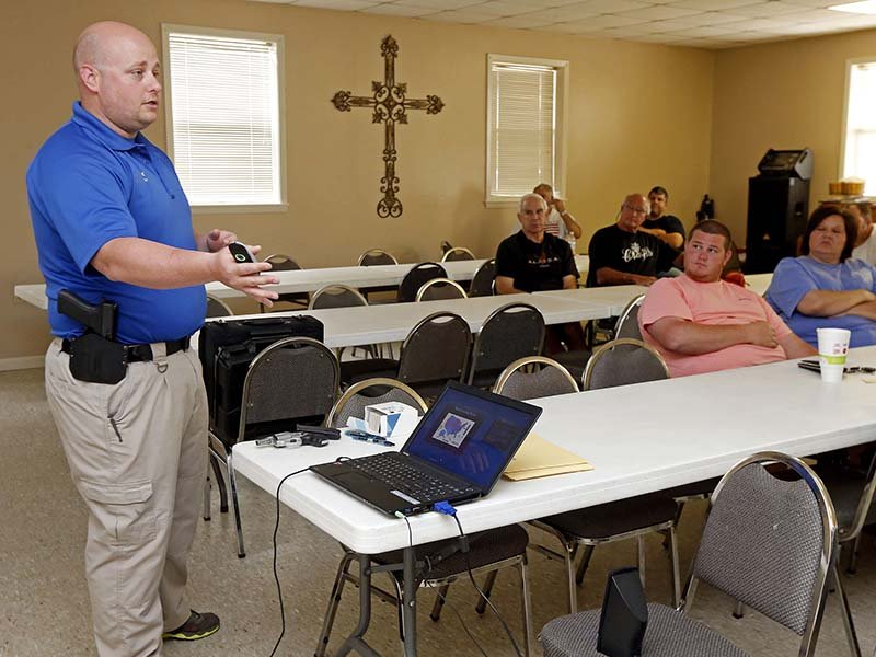 In this April 30, 2016, photograph, Jake Driskell, a Laurel, Miss., police officer and owner of Gun Guy Tactical, explains the specifics of Mississippi's enhanced concealed carry law with Crestview Baptist Church members and area residents in Petal, Miss. The 20 participants in the class received hands-on assistance during a practical shooting exercise, a thorough review on the fundamentals of safe handling of firearms and a review of the state's basic and enhanced concealed carry laws. (AP Photo/Rogelio V. Solis) (Caption amended by RNS)