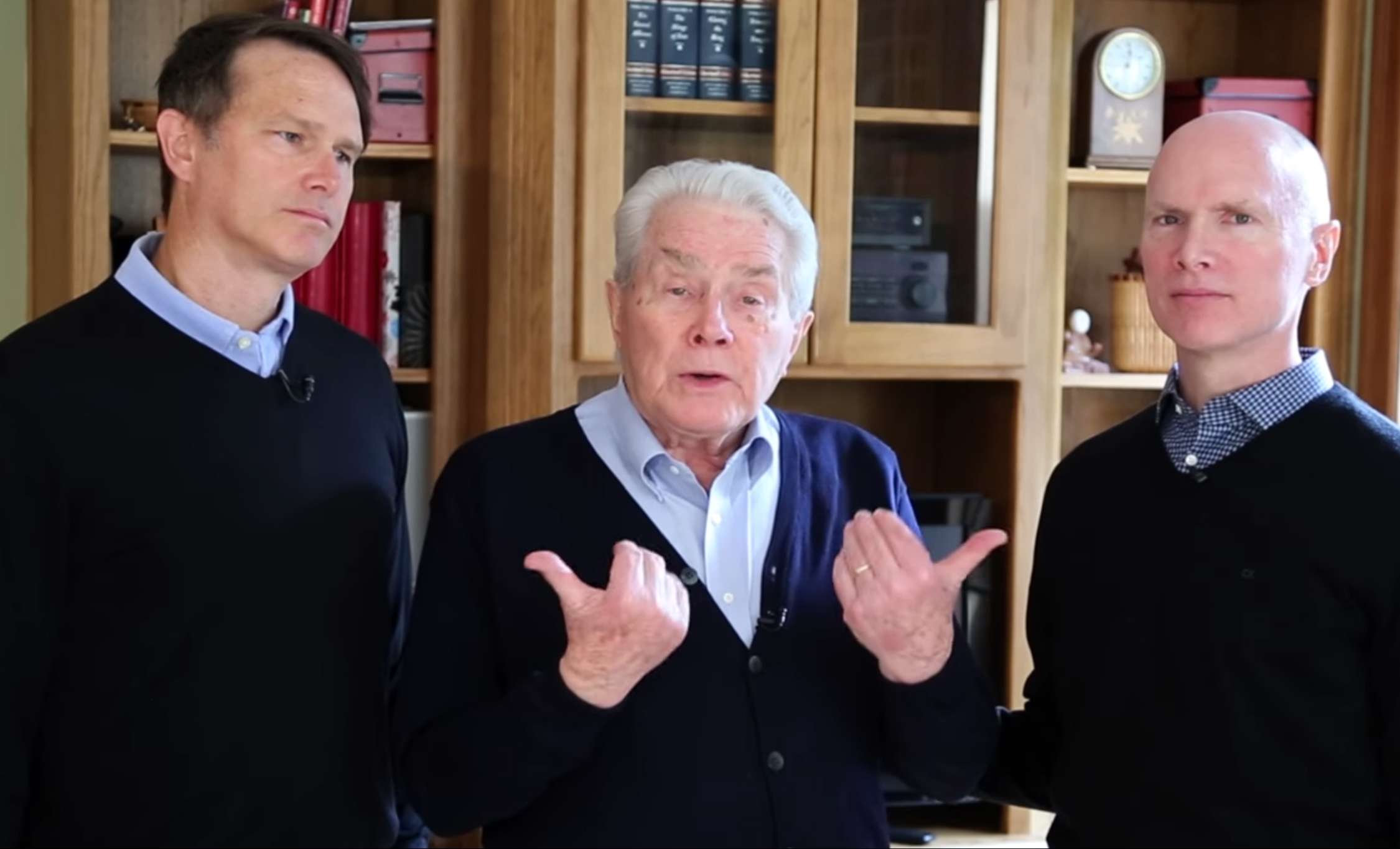 Luis Palau, center, announces his cancer diagnosis via video on his website Palau.org with his sons Andrew, left, and Kevin, right. Video screenshot