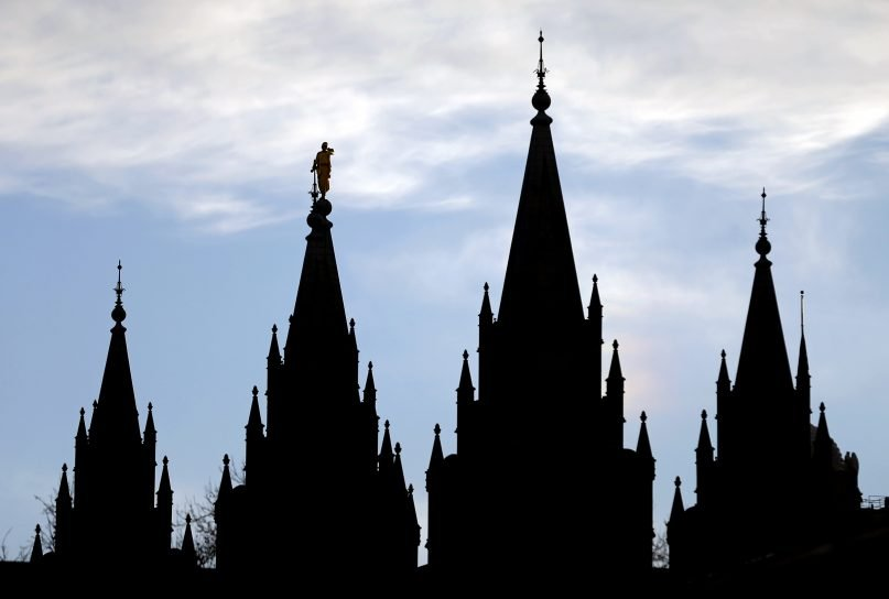 The angel Moroni statue, silhouetted against the sky, sits atop the Salt Lake Temple, at Temple Square, on Jan. 3, 2018, in Salt Lake City. (AP Photo/Rick Bowmer)