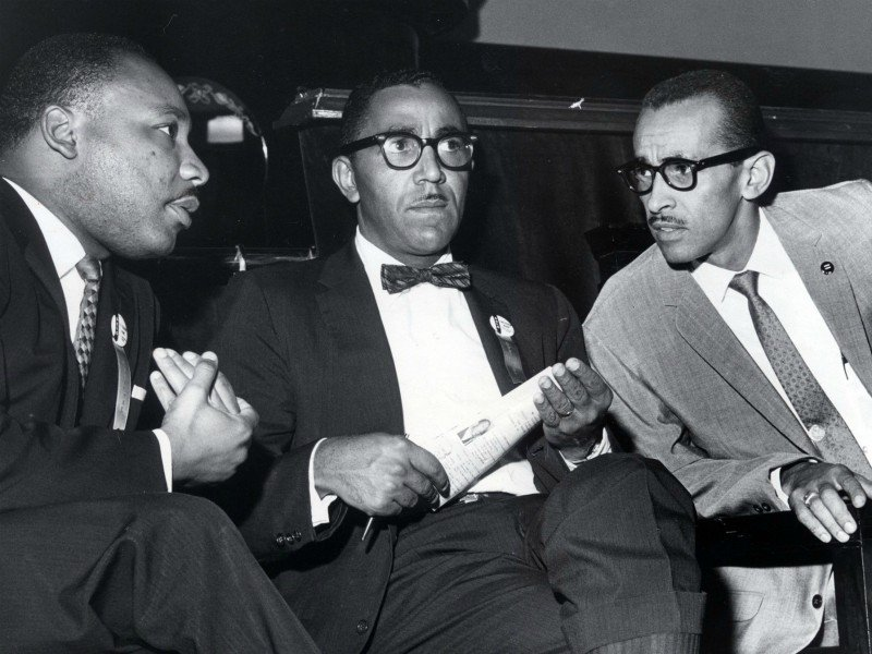 The Rev. Martin Luther King Jr., left, meets with the Rev. Joseph E. Lowery, center, and the Rev. Wyatt Tee Walker at First African Baptist Church in Richmond, Va., for the Southern Christian Leadership Conference convention on Sept. 25, 1963. Lowery died Friday (March 27) at age 98. King was SCLC president at the time, Lowery was vice president and Walker was executive director. (Carl Lynn/Richmond Times-Dispatch via AP)