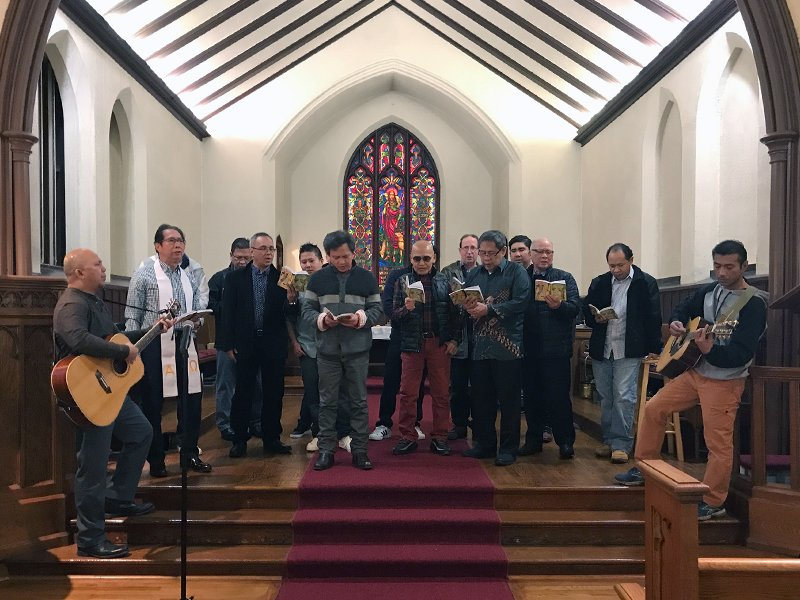 Asylum seeker Harry Pangemanan, right, plays guitar during the Indonesian service at the Reformed Church of Highland Park on Jan. 28, 2018, in Highland Park, N.J. RNS photo by Chris Sagona