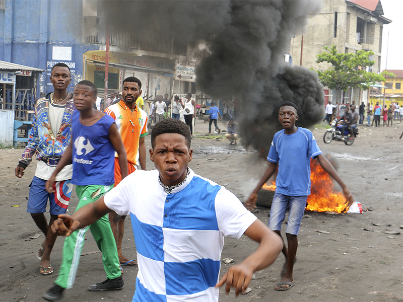 Congolese young men take part in a protest against President Joseph Kabila's refusal to step down from power in Kinshasa, Democratic Republic of Congo, on Dec. 31, 2017. Congolese security forces shot dead two men outside a church that day while dispersing demonstrators protesting in the country's capital against President Joseph Kabila's refusal to step down from power, according to Human Rights Watch. (AP Photo/John Bompengo; caption amended by RNS)