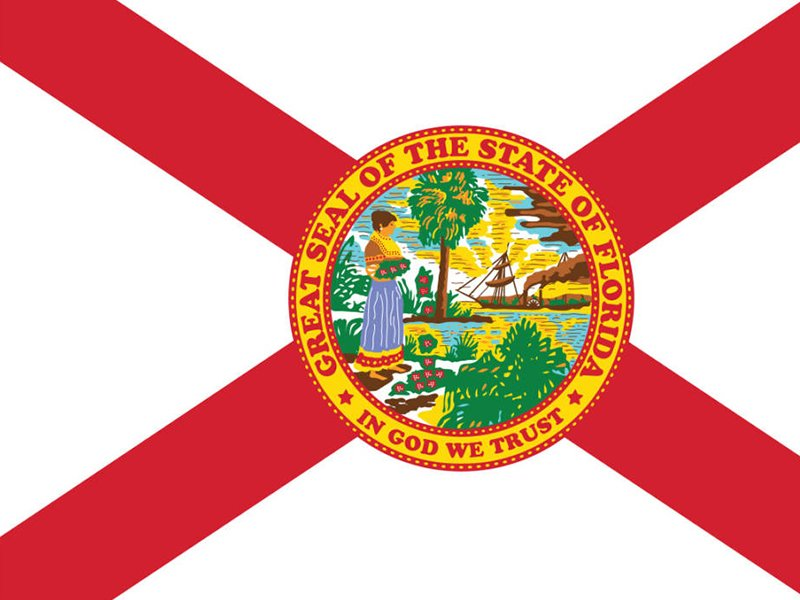 """The phrase """"In God We Trust"""" first appeared on the Florida state flag as part of the state seal in 1868. It became the state's motto in 2006. Image courtesy of Creative Commons"""