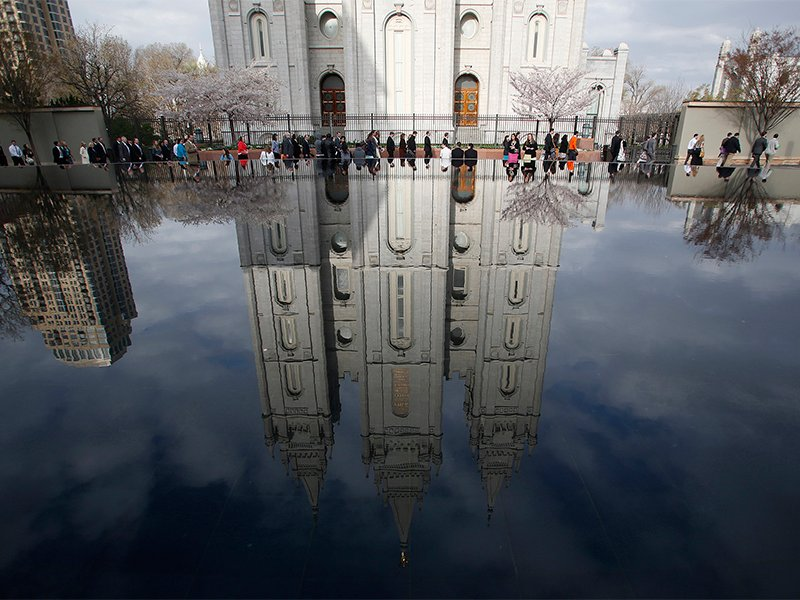 People walk past Salt Lake temple as they arrive to attend the biannual general conference of the Church of Jesus Christ of Latter-day Saints in Salt Lake City on April 5, 2014. Photo by Jim Urquhart/Reuters