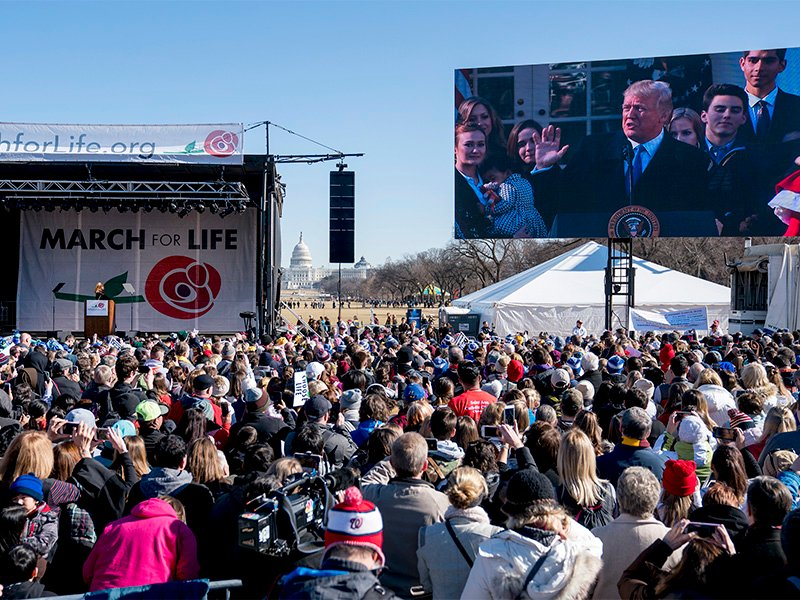 President Trump speaks via a live feed to anti-abortion activists as they rally on the National Mall in Washington, on Jan. 19, 2018, during the annual March for Life. Thousands of anti-abortion demonstrators gather in Washington for an annual march to protest the Supreme Court's landmark 1973 decision that declared a constitutional right to abortion. (AP Photo/Andrew Harnik)