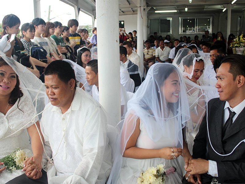 Forty-eight couples participate in a mass wedding in the Philippines. The veil and the cord are traditional aspects of Filipino weddings. Photo courtesy of Food for the Hungry