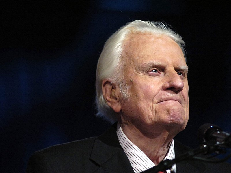 """Evangelist Billy Graham preaches to a crowd of more than 17,000 people at the New Orleans Arena during the """"Celebration of Hope'' hosted by the Billy Graham Evangelistic Association and Samaritan's Purse, on March 12, 2006. RNS photo by Jennifer Zdon/The Times-Picayune"""