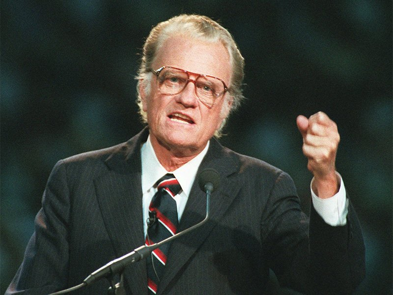 Evangelist Billy Graham begins his sermon in Atlanta's Georgia Dome on Oct 26, 1994. Graham, who transformed American religious life through his preaching and activism, becoming a counselor to presidents and the most widely heard Christian evangelist in history, has died. Spokesman Mark DeMoss says Graham, who long suffered from cancer, pneumonia and other ailments, died at his home in North Carolina on Wednesday, Feb. 21, 2018. He was 99. (AP Photo/John Bazemore, File)